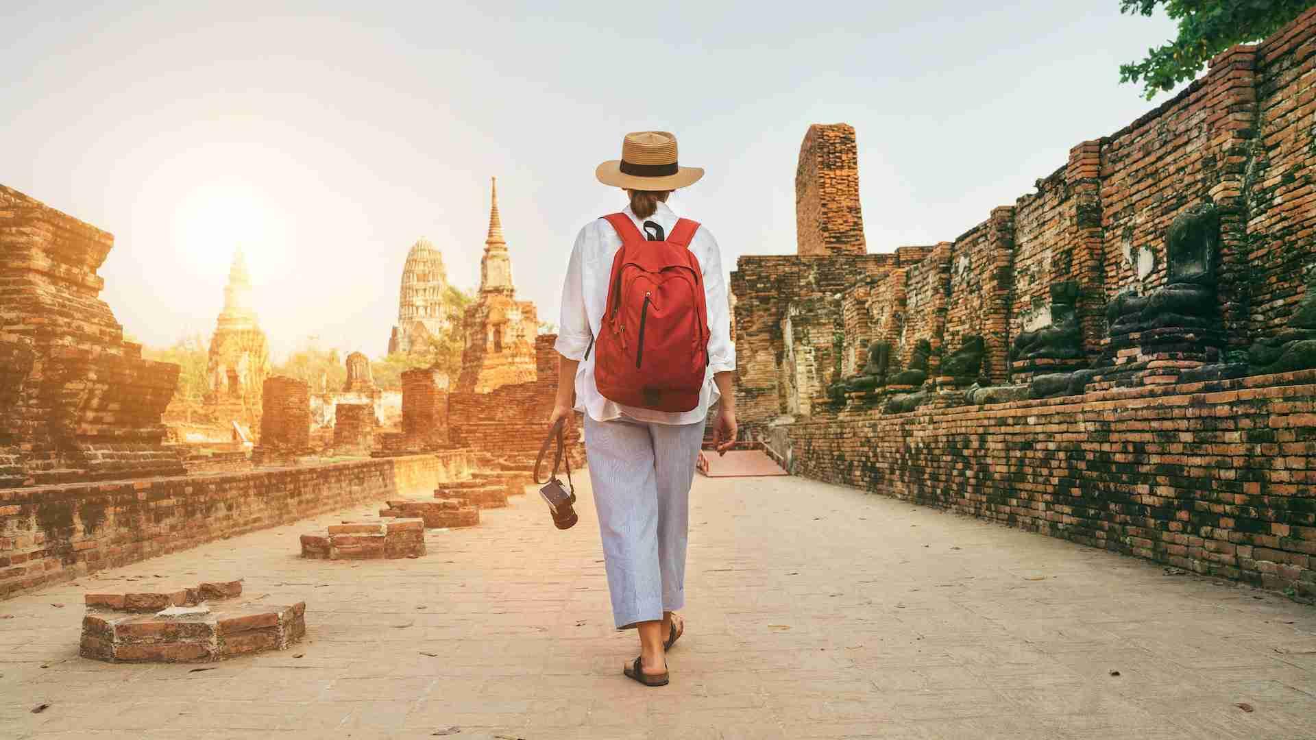 Photo of a woman walking through Ayutthaya, Thailand, on Private Photo Tours.